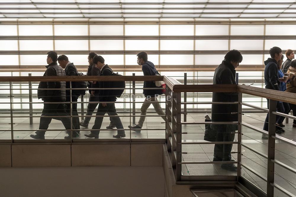 businessmen walking in office building Japan Tokyo Roppongi