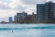 Surfing at Waikiki Beach, Honolulu, Oahu, Hawaii