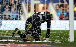 Queens Park Rangers goalkeeper Joe Lumley finds himself tangled in the goal net