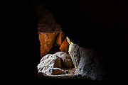 Light shines into a section of the Balconies Cave, a talus cave in Pinnacles National Park, California. The park's high peaks are partial remnants of the ancient Pinnacles volcano, shifted 190 miles north of its original location due to movement of the San Andreas Fault. Talus caves, like Balconies Cave, are narrow passages in the piles of large rocks that have broke off and landed at the base of the peaks.