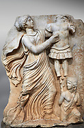 Roman Sebasteion relief  sculpture of a Goddess inscribing a trophy, Aphrodisias Museum, Aphrodisias, Turkey.  Against an art background.<br /> <br /> A draped goddess strides forward to inscribe a military trophy to which is bound a kneeling female captive. The goddess is probably a personification such as Honour, Virtue or Courage. .<br /> <br /> If you prefer to buy from our ALAMY STOCK LIBRARY page at https://www.alamy.com/portfolio/paul-williams-funkystock/greco-roman-sculptures.html . Type -    Aphrodisias     - into LOWER SEARCH WITHIN GALLERY box - Refine search by adding a subject, place, background colour, museum etc.<br /> <br /> Visit our ROMAN WORLD PHOTO COLLECTIONS for more photos to download or buy as wall art prints https://funkystock.photoshelter.com/gallery-collection/The-Romans-Art-Artefacts-Antiquities-Historic-Sites-Pictures-Images/C0000r2uLJJo9_s0