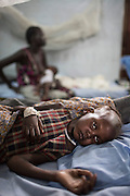 """Mcc0075406 . Daily Telegraph<br /> <br /> DT Foreign<br /> <br /> Nyalok Mabor 45 yrs with her daughter Dalia who is suffering from severe malnutrition .<br /> <br /> The IMC Paediatric ward in POC 3 , a """"Protection of Civilian Camp"""" inside the vast UN compound on the outskirts of Juba . Parents bring their children in with acute malnutrition needing urgent treatment .<br /> <br /> Over 20,000 civilians who predominantly fled from conflict in the equatorial states of South Sudan . United Nation's agencies recently announced a famine in the war torn country .<br /> <br /> Juba 27 February 2017"""