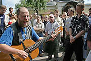 Moscow, Russia, 25/07/2004..Hundreds of Russians gather at the grave of legendary dissident singer, poet and actor Vladimir Vysotsky to mark the anniversary of his death. Vysotsky, who died in 1980 aged 42 of a heart attack, is best known for his songs of Soviet prison life. Much of his work was officially unpublished during his lifetime, and he remains a potent anti-authoritarian symbol of protest to Russians of all ages even today.
