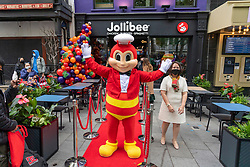 © Licensed to London News Pictures. 20/05/2021. London, UK. Customers queue up to enter the new Jollibee fried chicken flagship restaurant in Leicester Square, West End. Established in 1978, the Filipino fast food company has over 1300 restaurants worldwide. Photo credit: Ray Tang/LNP
