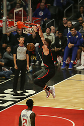 December 17, 2018 - Los Angeles, CA, U.S. - LOS ANGELES, CA - DECEMBER 17: Portland Trail Blazers Center Jusuf Nurkic (27) holds on to the rim after a dunk during the Portland Trail Blazers at Los Angeles Clippers NBA game on December 17, 2018 at Staples Center in Los Angeles, CA.. (Photo by Jevone Moore/Icon Sportswire) (Credit Image: © Jevone Moore/Icon SMI via ZUMA Press)
