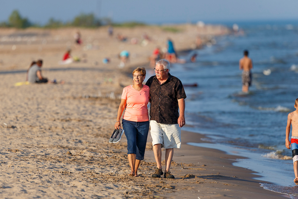 Richard and Lyn Hanke walk the beach at Neshota Park in Two Rivers, Wisconsin.  Photo by Mike Roemer
