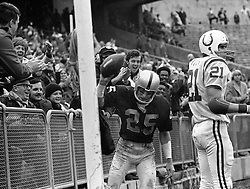 Oakland Raider Fred Biletnikott spikes the ball in the end zone to the delight of the fans. Colt #21..<br />(photo by Ron Riesterer)