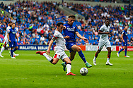 Bournemouth defender Adam Smith (15) under pressure from Cardiff City forward Mark Harris  (29) during the EFL Sky Bet Championship match between Cardiff City and Bournemouth at the Cardiff City Stadium, Cardiff, Wales on 18 September 2021.