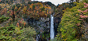 Kegon Waterfall (Kegon no taki, 97 metres or 318 ft) is the thundering outlet of Lake Chuzenji. Paying for the 100 meter deep elevator gives more impressive views than the free viewing above. Kegon Waterfall  is a short walk from Chuzenjiko Onsen bus terminal. Nikko National Park, Tochigi Prefecture, Japan. This image was stitched from multiple overlapping photos.