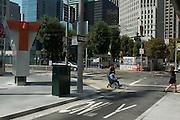 Bruce Oka heads toward the bus ramp outside of the Temporary Transbay Terminal in San Francisco