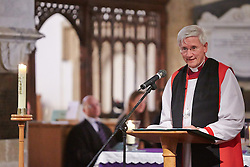© Licensed to London News Pictures.  17/11/2013. THAME, UK. Reverend Colin Fletcher, Bishop of Dorchester, addresses the congregation during the annual Road Deaths Memorial Service held in St Marys Church, Thame. 78 people were killed in traffic accidents in the Thames Valley Police area last year.  Photo credit: Cliff Hide/LNP
