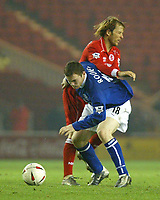 Photo. Andrew Unwin.<br /> Middlesbrough v Everton, Carling Cup Fourth Round, Riverside Stadium, Middlesbrough 03/12/2003.<br /> Everton's Wayne Rooney holds off Middlebrough's Gaizka Mendieta.
