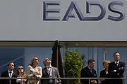 Guests admire aerobatic flying displays outside the EADS hospitality chalet at the Farnborough Air Show. The European Aeronautic Defence and Space Company N.V. (EADS) is a global pan-European aerospace and defence corporation and a leading defence and military contractor worldwide. The group includes Airbus as the leading manufacturer of commercial aircraft, with Airbus Military covering tanker, transport and mission aircraft; Eurocopter as the world's largest helicopter supplier; Astrium, the European leader in space programmes from Ariane to Galileo; and Cassidian as a provider of comprehensive and integral systems solutions for aerial, land, naval and civilian security applications.