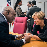 CHARLOTTE NC- Vi Lyles, the first female African-American mayor of Charlotte, greets Harvey Gantt, the first African-American mayor of Charlotte greet after her swearing in ceremony.