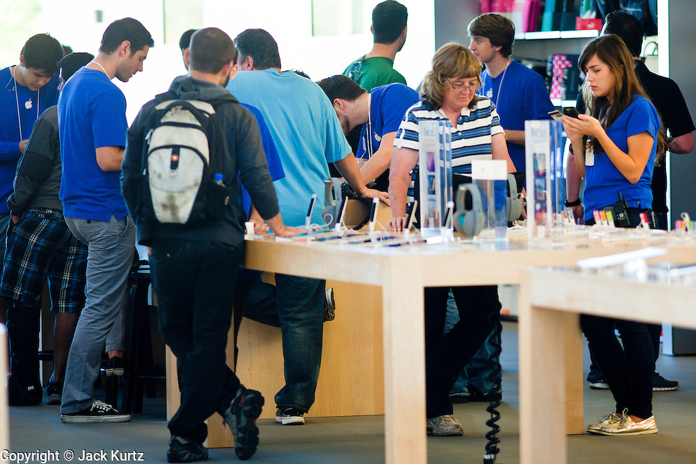 14 OCTOBER 2011 - SCOTTSDALE, AZ:   Shoppers in the Apple Store in the Scottsdale Quarter shop for the iPhone 4S and accessories Friday morning. Hundreds of people lined up at the Apple Store in the Scottsdale Quarter in Scottsdale, AZ, Friday, Oct. 14, to buy the iPhone 4S. The phone sold out in pre-orders last week and sales at the Scottsdale Apple Store were brisk through the morning.     PHOTO BY JACK KURTZ
