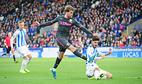 Leeds United's Patrick Bamford vies for possession with Huddersfield Town's Christopher Schindler<br /> <br /> Photographer Chris Vaughan - CameraSport<br /> <br /> The EFL Sky Bet Championship - Huddersfield Town v Leeds United - Saturday 7th December 2019 - John Smith's Stadium - Huddersfield<br /> <br /> World Copyright © 2019 CameraSport. All rights reserved. 43 Linden Ave. Countesthorpe. Leicester. England. LE8 5PG - Tel: +44 (0) 116 277 4147 - admin@camerasport.com - www.camerasport.com