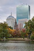 USA, Massachusetts, Boston. Boston Public Garden Hancock Tower in the background in Autumn