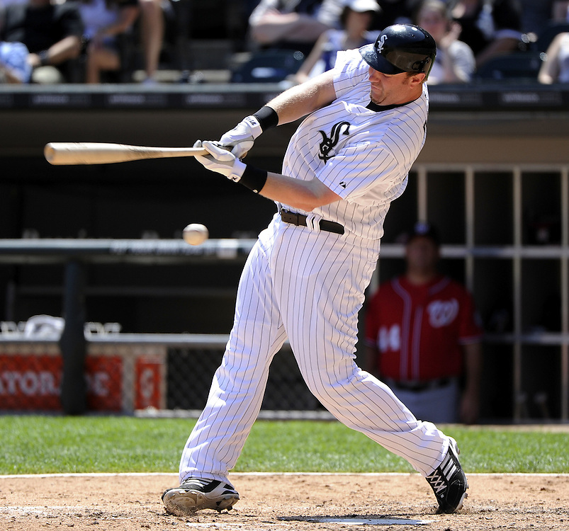 CHICAGO, IL - JUNE 26:  Adam Dunn #32 of the Chicago White Sox swings and misses at a pitch against the Washington Nationals on June 26, 2011 at U.S. Cellular Field in Chicago, Illinois.  The Nationals defeated the White Sox 2-1.  (Photo by Ron Vesely/MLB Photos via Getty Images)  *** Local Caption *** Adam Dunn