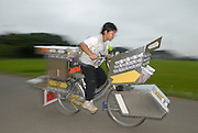 """Shota Hashimoto (13) rides his decochari customized bicycle along the side of a rice field. """"My friends are pretty impressed."""""""