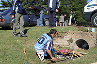 """30/04/04 Less than 24 hs after leaving the hospital, Diego Maradona played golf on a private field 50 km. outside Buenos Aires. The entrance of the field was full of journalist and fans making tributes for the soccer idol, and the tipical """"asado"""".<br /> <br /> Foto: Piko-Press/Digitalsport<br /> NORWAY ONLY"""