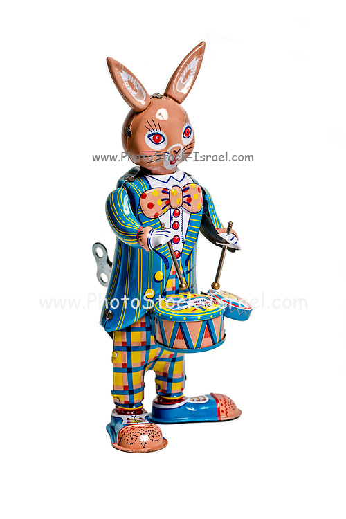 tin windup toy rabbit drummer isolated on white