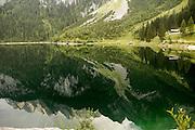 Austria, Upper Austria, Gosau, Lake Gosau in the Dachstein Mountains the mountains reflecting in the calm clear water