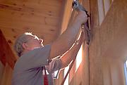 Carpenter age 55 remodeling cabin on Roy Lake.  Nisswa  Minnesota USA