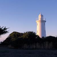 Australia, Tasmania, The Devonport Lighthouse sits atop Mersey Bluff overlooking Bass Strait, which separates Tasmania from mainland Australia