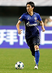 ZHUHAI, July 19, 2017 Atsuto Uchida of FC Schalke 04 controls the ball during a pre-season soccer match between Bundesliga's FC Schalke 04 and Turkish Super League champion Besiktas JK at Zhuhai Sports Center Stadium in Zhuhai, south China's Guangdong Province, July 19, 2017. FC Schalke 04 won 3-2. (Credit Image: © Wang Lili/Xinhua via ZUMA Wire)