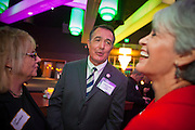 """11 DECEMBER 2011 - SCOTTSDALE, AZ:    Congressman Trent Franks (R-AZ) talks to conservative supporters of Michele Bachmann at a Bachmann fundraiser sponsored by Politics on the Rocks at the Mint in Scottsdale, AZ, Sunday. The Mint is a popular bar and restaurant built in a former bank in Scottsdale, AZ. Politics on the Rocks was started by Charles A. Jensen in Scottsdale, Arizona. The purpose of """"Politics on the Rocks"""" is to bring Republican & Conservative Professionals together in a monthly happy hour where they can network, socialize, and hear directly from prominent politicians and successful business leaders.    PHOTO BY JACK KURTZ"""