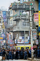"Bagbazar, 18 February 2005. Armed Police Forces blocking ordinary people from crossing the main road during the nation's Democracy Day. Authorities have once again cut off local telephone lines. ""Today we have arrested several people. They were planning pro-democracy rallies, but we didn't give them any chance to demonstrate"", a police officer says."