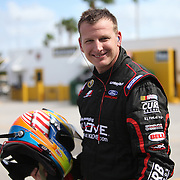 NASCAR Sprint Cup driver Michael McDowell (98) is seen in the garage area during the NASCAR Coke Zero 400 Sprint practice session at the Daytona International Speedway on Thursday, July 4, 2013 in Daytona Beach, Florida.  (AP Photo/Alex Menendez)