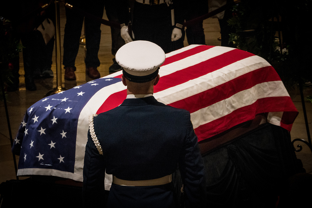 A member of a military honor guard stands over Former President Bush's casket in the U.S. Capitol rotunda on Dec. 3, 2018.