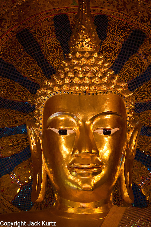 24 JUNE 2011 - CHIANG MAI, THAILAND: The Buddha head at Wat Phra Singh in Chiang Mai, Thailand. Wat Phra Singh is the most revered Buddhist temple in Chiang Mai because it houses the Phra Singh (Lion Buddha). The exact origin of the Buddha is unknown though it is known to have resided in Buddhist temples in Sukothai, Ayuthaya, Chiang Rai and Luang Prabang before coming to Chiang Mai in approximately 1360.  PHOTO BY JACK KURTZ