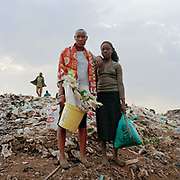 Alice (left) sstarted coming to the dump last year when she fell pregnant and had to drop out of school. She needs the money to support her. She is holding some plastic  flowers which she might be able to sell it being Valentinies day, a big event in Kenya. She goes to the dump with Fatila who laso lives with her and her dad ( her baby is looked after by relatives) . She helps to protect Fatila from some of the boys at the dump – they ask her to sell Fatila to them but she doesn't allow them near her. The two girls take care of each other, Fatila says that Alice gives her advice about sex and boys, warning her not to end up in the same situation.