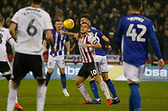 Sheffield United forward Billy Sharp (10) shields the ball from Sheffield Wednesday defender Morgan Fox (6)  during the EFL Sky Bet Championship match between Sheffield United and Sheffield Wednesday at Bramall Lane, Sheffield, England on 9 November 2018.