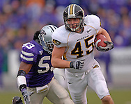 Missouri tight end Chase Coffman (45) rushes up field for a first down in the second half against Kansas State at Bill Snyder Family Stadium in Manhattan, Kansas, November 19, 2005.  K-State defeated the Missouri Tigers 36-28.