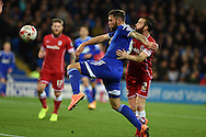 Daryl Murphy of Ipswich Town holds off John Brayford of Cardiff. . Skybet football league championship match, Cardiff city v Ipswich Town at the Cardiff city stadium in Cardiff, South Wales on Tuesday 21st October 2014<br /> pic by Andrew Orchard, Andrew Orchard sports photography.