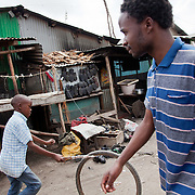 Robert Bolimo, 23, ( on the right )is a Nairobits graduate. He works as an intern at Jengo Web in down town Nairobi and he hopes to be able to stay on and  get a job at Jenga Web.  Robert came to Nairobi in 1992 and lives alone in Mukuru slum. His family live 450 km out of Nairobi, Robert is their only hope for a better life and financial security..Nairobits is a charity teaching kids from Nairobi's slums IT and train them to get work in the IT sector.Every year 1mill young people graduate and leave school and only 1/3 have any hope of getting a job. Nairobits aim to train more than 500 young people / year from the slums, some with only basic formal education, how to set up their own business or get a job in the growing IT sector in Kenya.
