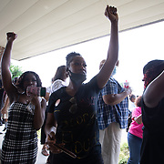 RAEFORD, NC - June 6: Mourners cheer the body of George Floyd as it arrives at Impact Church, where a memorial service will be held in his honor in Raeford, NC on June 6, 2020. The 3 day tour will culminate with Floyd's funeral in Houston, Texas. (Photo by Logan Cyrus for AFP)