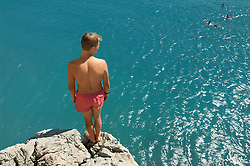 Waiting up high teenager cliff diving holiday