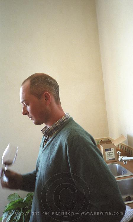 Bertrand de Mortillet, owner and wine maker at Domaine de la Prose, tasting his wine, Coteaux du Languedoc St-George-d'Orques, Languedoc-Roussillon, France Grain grainy.