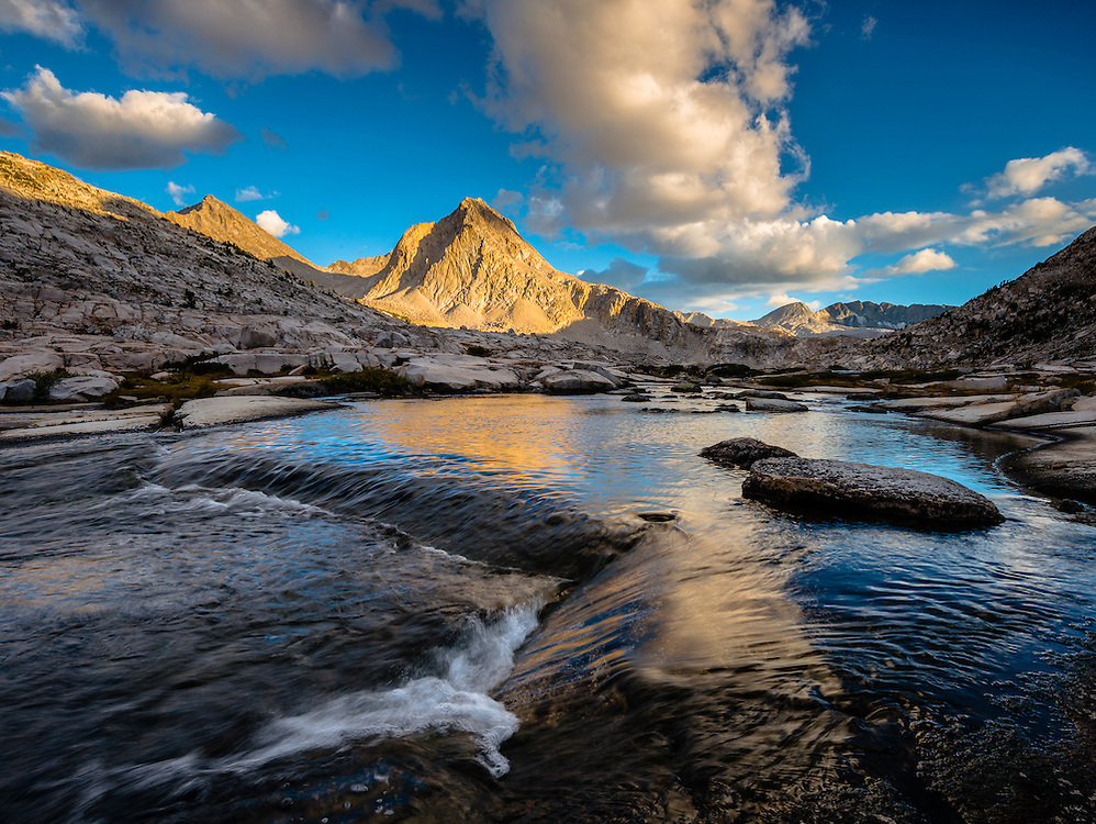 Mt Huxley and Mt Spencer catch the last light of the day reflecting in the outlet of Sapphire Lake.