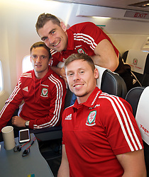ZENICA, BOSNIA & HERZEGOVINA - Sunday, October 11, 2015: Wales' Andy King, Sam Vokes and Simon Church on the team's return flight to Cardiff after qualifying for the UEFA Euro 2016 finals despite a 2-0 defeat to Bosnia and Herzegovina during the UEFA Euro 2016 qualifying match. (Pic by David Rawcliffe/Propaganda)
