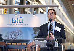 Tom Sheaff, of Lennar Mare Island addresses the crowd as Blu Homes opens their West Coast factory on Mare Island in Vallejo, California Dec. 1, 2011.  Over 400 guests attended a ribbon cutting ceremony at the 250,000-square-foot facility.