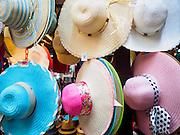 06 JUNE 2015 - KUALA LUMPUR, MALAYSIA:  Women's sun bonnets for sale in the Chinatown section of Kuala Lumpur.    PHOTO BY JACK KURTZ