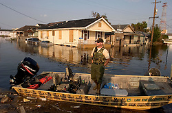 05 Sept  2005. New Orleans, Louisiana. Post hurricane Katrina.<br /> Animal rescue boat. A horse is rescued from the devastating floods in Uptown New Orleans by the Kentucky Dept of Fish and Wildlife Dept.<br /> Photo; ©Charlie Varley/varleypix.com