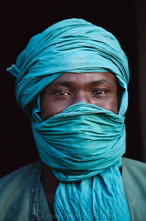 (MODEL RELEASED IMAGE). Soumana Natomo of Kouakourou, Mali, wraps his head and face for protection against many different elements. Hungry Planet: What the World Eats (p. 212). The Natomo family of Kouakourou, Mali, is one of the thirty families featured, with a weeks' worth of food, in the book Hungry Planet: What the World Eats.