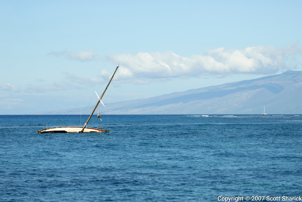 A sailboat lays on its side off Lahaina, Maui in Hawaii.