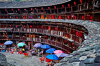 """Chine, Province du Fujian, village de Yuchang Lou, maison forteresse en terre et en bois où logent les membres d'une meme famille de l'ethnie Hakka, inscrit au patrimoine mondial de l'Unesco // China, Fujian province, Yuchang Lou village, Tulou mud house. well known as the Hakka Tulou region, in Fujian. In 2008, UNESCO granted the Tulou """"Apartments"""" World Heritage Status, siting the buildings as exceptional examples of a building tradition and function exemplifying a particular type of communal living and defensive organization. The Fujian Tulou is """"the most extraordinary type of Chinese rural dwellings"""" of the Hakka minority group and other people in the mountainous areas in southwestern Fujian."""